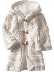 Crocheted coat for a little girl.